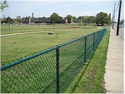 Fence along southern edge of East High Campus between the athletic fields and Poplar Avenue.
